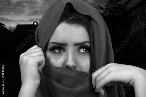 Woman escape into the night covering face