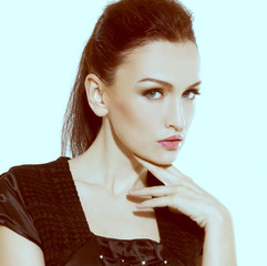 Portrait of face of brunette woman with fashion makeup