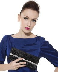 brunette woman with fashion makeup and red lips holding purse