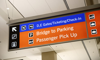 Ticketing, Check-in, and Passenger pick-up sign