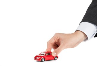 toy car and hand of man, concept for costs