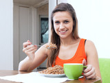 woman eats buckwheat porridge