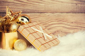gift box with christmas decoration on wooden background