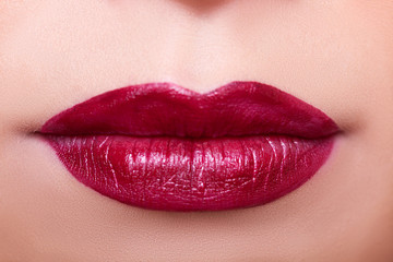 Close up lips with red lipstick