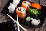 Maki Sushi on wooden background