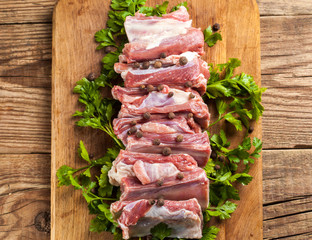 Raw pork ribs on a cutting board
