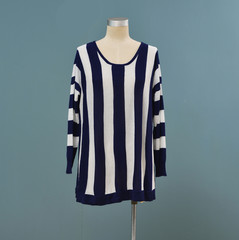 Female stripy clothing on mannequin isolated