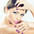 Beautiful model with lilac makeup and manicure.