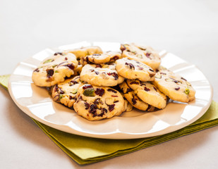 Cranberry cookies on plate and green napkin
