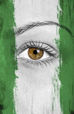 Nigeria flag painted over female face