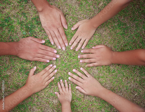 Image of hand on grass as circle form