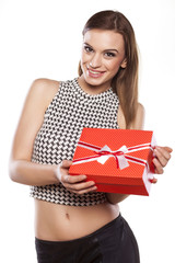 beautiful smiling girl holding a gift box on a white background