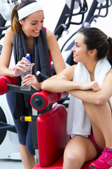 women relaxing in the gym after making exercise