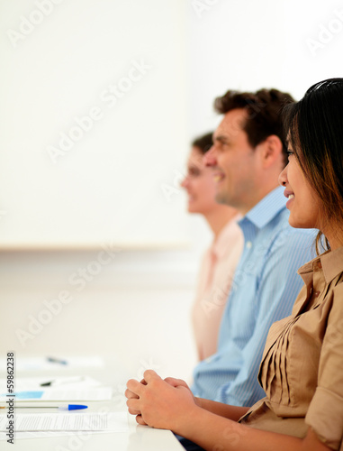 Team of coworkers listen during a conference