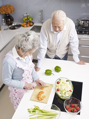 senior couple chatting in kitchen