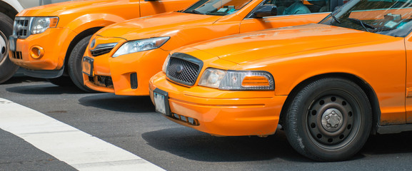 Taxis in New York. Yellow cabs in pole position at traffic light