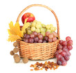 Grape in basket with nuts isolated on white