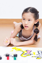 Little Asian artist girl drawing and painting