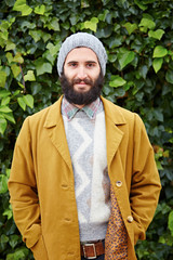 Smiling hipster bearded male student