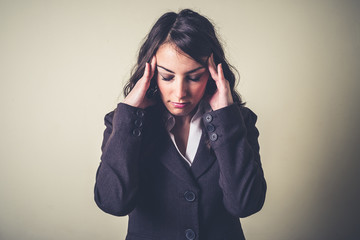 stressed beautiful young businesswoman