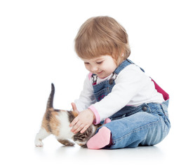 happy kid playing with cat kitten