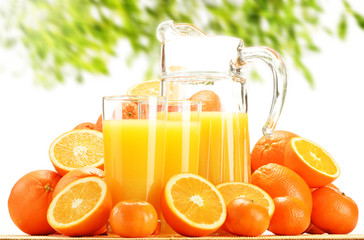 Composition with glasses of orange juice and fruits