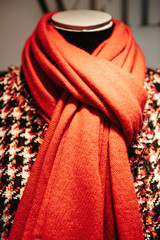 Mannequin wearing red scarf