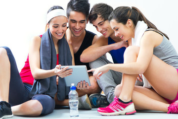 young people looking at digital table in the gym