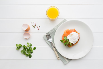 Top view of healthy breakfast with poached eggs royale