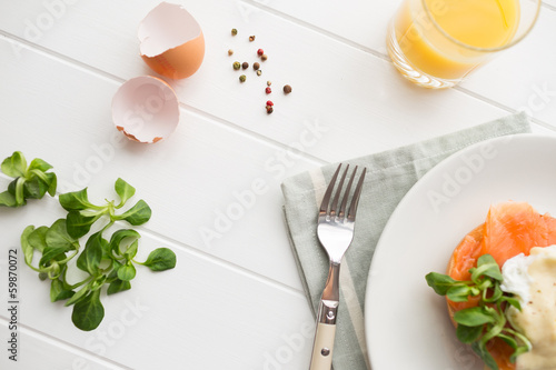Fresh breakfast with salmon, eggs and orange juice