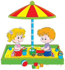 girl and boy playing in a sandbox