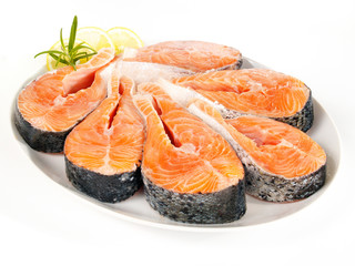 Raw salmon steaks on a plate