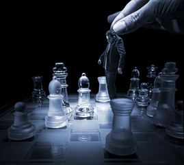 .Businessman on a chessboard as a dummy