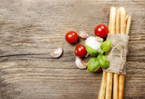 Traditional italian breadsticks on wooden background. Top view,