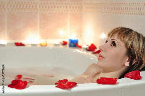 A girl takes a bath in the foam