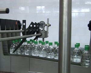 Conveyor for the production of carbonated drink