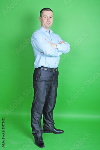 young business man in a blue shirt in the chair