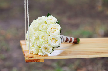 bridal bouquet on swing