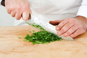 Chef chopping tarragon