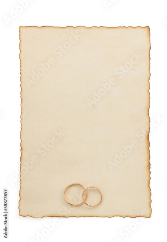 wedding ring and aged paper