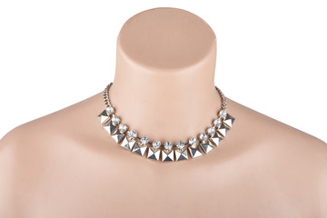 Beautiful silver statement necklace on mannequin isolated on whi