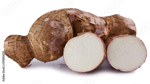 cutting and whole manioc (cassava) isolated on white background