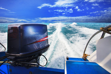 rear view from speed boats running against clear sea blue water