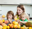 Mother and children with peaches
