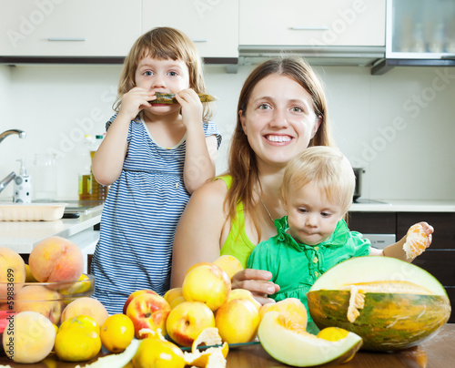 Happy family together with melon
