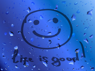 Smile. Life is good. Inscription on wet glass