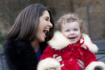 mother and daughter laughing together