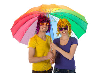 Trendy couple with sunglasses, wigs and unbrella