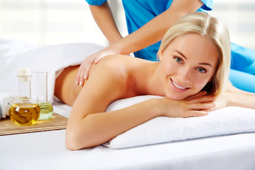 Young beautiful woman in spa environment