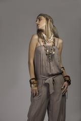 Blonde woman in bohemian clothing looking away
